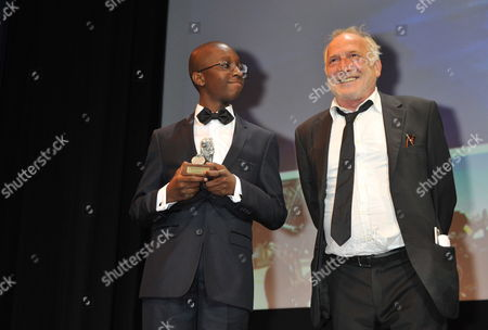 French Actor Andre Wilms (r) and Blondin Miguel Pose For a Photograph with the Arri Prize 2011 For Their Film 'Le Havre' During the Munich Film Festival in Munich Germany 01 July 2011 Munich Film Festival Takes Place From 24 June to 02 July 2011 Germany Munich