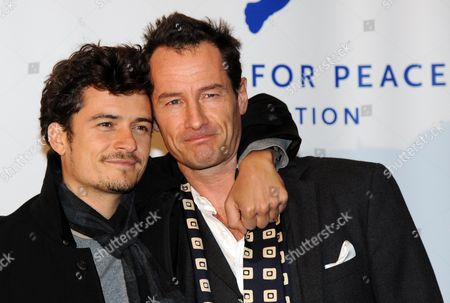 Us Actor Orlando Bloom (l) and the Photographer and Environmental Activist Sebastian Copeland (r) Arrive at the 2010 Cinema For Peace Green Evening in Berlin Germany 12 November 2010 Orlando Bloom is Guest of the Evening Ceremony to Promote Sebastian Copeland's Fascinating Movie 'Into the Cold - a Journey of Soul' Germany Berlin