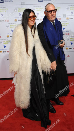 Swiss Star Photographer Michel Comte and His Wife Ayako Arrive For the Charity Event Cinema For Peace in Berlin Germany 14 February 2011 Since 2002 Cinema For Peace Has Been a Worldwide Initiative Promoting Humanity Through Film While Inviting Members of the International Film Community to Attend the Annual Cinema For Peace Award-gala-night During the Berlin International Film Festival Germany Berlin
