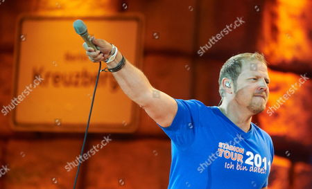 German Comedian Mario Barth Performs on Stage During His Show ' Men Are Embarassing and Women Sometimes Also ' at the Veltins-arena in Gelsenkirchen Western Germany on 18 June 2011 Germany Gelsenkirchen