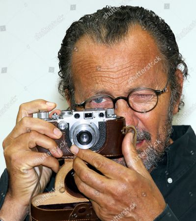Italian Fashion Photographer Paolo Roversi Uses His Favourite Camera of the Brand Leica During a Preview of His Exhibition 'Studio' in Rostock Germany 10 September 2010 the Exhibition Which Opens on 12 September 2010 Presents Large-sized Photos and Polaroids of the Series 'Nudi' Consisting in Nude Photographs of Actresses and Supermodels Germany Rostock