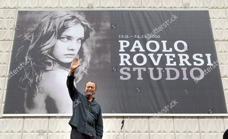 Italian Fashion Photographer Paolo Roversi Stands in Front of a Large Poster on the Roof of Rostock Kunsthalle (art Gallery) During a Preview of His Exhibition 'Studio' in Rostock Germany 10 September 2010 the Exhibition Which Opens on 12 September 2010 Presents Large-sized Photos and Polaroids of the Series 'Nudi' Consisting in Nude Photographs of Actresses and Supermodels the Poster Represents Russian Model Natalia Vodianova Germany Rostock