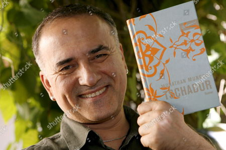 Stock Photo of Turkish Author Murathan Mungan Presents His Book 'Tschador' at an Interview in Erlangen Germany 30 August 2008 'Tschador' is Mungan's Second Publication in Germany After the Avowing Gay Had Published More Than 50 Books in Turkey Germany Erlangen