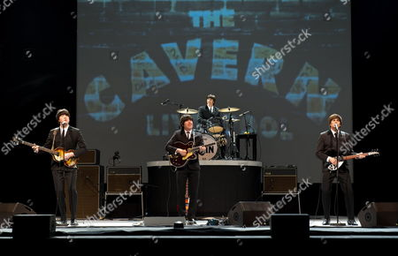 (l-r) Members of the Beatles Cover Band 'Rain' Graham Alexander As Paul Mccartney Tom Teeley As George Harrison Joe Bologna As Ringo Starr and Steve Landes As John Lennon Perform During the Rehearsals of Their Show 'Rain a Tribute to the Beatles' in Berlin Germany 13 April 2010 the Premiere of the Show and the Beginning of Their Germany Tour Takes Place on 13 April 2010 Germany Berlin