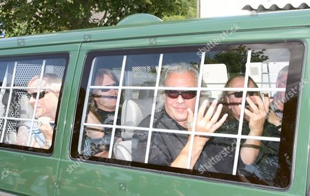Members of British Rock Band 'Uriah Heep' Phil Lanzon (l Front) Mick Box (r Front) Bernie Shaw (l Back) and Travor Bolder (r Back) Arrive at the Prison in Rottenburg Near Stuttgart Germany 24 July 2008 the Band Later Performed in Front of the Jail's 500 Prisoners Germany Rottenburg