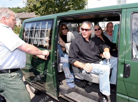 Prison Officers Open the Door of a Vehicle Transporting Members of British Rock Band 'Uriah Heep' Phil Lanzon (c) Mick Box (2-r) and Travor Bolder (back Seat) in Rottenburg Near Stuttgart Germany 24 July 2008 the Band Later Performed in Front of the Jail's 500 Prisoners Germany Rottenburg