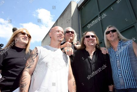 Members of British Rock Band 'Uriah Heep' (l-r) Travor Bolder Rusell Gilbrook Phil Lanzon Mike Box and Bernie Shaw Pose in Front of the Prison in Rottenburg Near Tuebingen Germany 24 July 2008 Later the Band Performed in Front of the Jail's 500 Detainees Germany Rottenburg