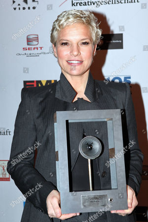 German Singer Ina Mueller Poses with the Music Award 'Hans' Which She Received For the Category 'Hamburg's Media-format of the Year' in Hamburg Germany 16 November 2010 the Music Award Initiated by the Hamburg Interest Group Music Industry (ihm) Awarded Artist of the Hamburg Music Szene in Eight Different Categories Germany Hamburg