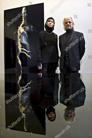 Actress Model Painter and Photographer Veruschka Von Lehndorff and Artist Holger Truelzsch Pose in Front of the Photography 'Yellow Flash' at the Vernissage of the Exhibition 'Veruschka' in the Gallery Lumas in Berlin Germany 29 January 2009 the Exhibition Can Be Visited Until 03 March 2009 Germany Berlin