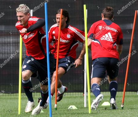 Players of German Soccer Club Fc Bayern Munich Sebastian Schweinsteiger (l) and Martin Demichelis (c) During a Training Session at the Club's Training Ground in Munich Germany 18 July 2008 Germany Munich