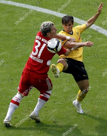 Tamas Hajnal (r) of Borussia Dortmund Vies For the Ball with Sebastian Schweinsteiger of Fc Bayern Munich During Their Bundesliga Soccer Match at Signal Iduna Park in Dortmund Germany 23 August 2008 (attention: Embargo Conditions! the Dfl Permits the Further Utilisation of the Pictures in Iptv Mobile Services and Other New Technologies No Earlier Than Two Hours After the End of the Match the Publication and Further Utilisation in the Internet During the Match is Restricted to Six Pictures Per Match Only ) Germany Dortmund