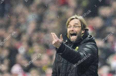 Stock Picture of Borussia Dortmund's Coach J?rgen Klopp Gestures During the German Bundesliga Soccer Match Between Bayern Munich and Borussia Dortmund in Munich Germany 26 February 2011 Dortmund Won the Match 1-3 (attention: Embargo Conditions! the Dfl Permits the Further Utilisation of the Pictures in Iptv Mobile Services and Other New Technologies Only No Earlier Than Two Hours After the End of the Match the Publication and Further Utilisation in the Internet During the Match is Restricted to Six Pictures Per Match Only ) Germany Munich