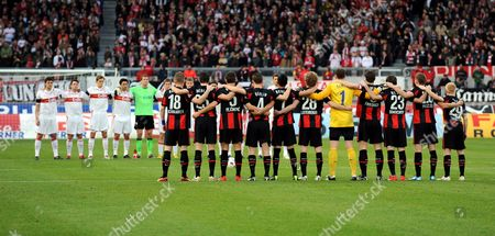 The Two Teams Stand Still During a Minute's Silence in Honour of Late German National Goalkeeper Robert Enke Ahead of the German Bundesliga Soccer Match Vfb Stuttgart Vs Hertha Berlin at Mercedes-benz Arena in Stuttgart Germany 21 November 2009 (attention: Blocking Period! the Dfl Permits the Further Utilisation of the Pictures in Iptv Mobile Services and Other New Technologies Only Two Hours After the End of the Match the Publication and Further Utilisation in the Internet During the Match is Restricted to Six Pictures Per Match Only ) Germany Stuttgart