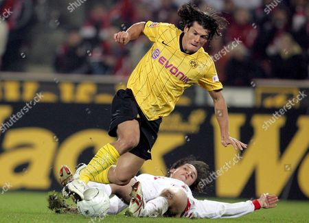 Cologne's Pedro Tonon Geromel (bottom) Tackles Borussia Dortmund Striker Nelson Valdez of Paraguay During the German Bundesliga Match in Cologne 29 October 2008 Germany Cologne