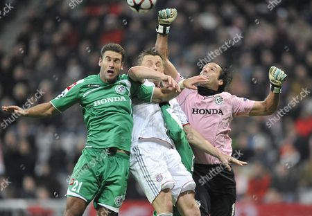 Munich's Ivica Olic (c) Jumps For the Ball with Maccabi Haifa Players Nir Davidovitch (r) and Dekel Keinan During the Group Phase Uefa Champions League Soccer Match Fc Bayern Munich Vs Maccabi Haifa at the Aliianz Arena Stadium in Munich Germany 25 November 2009 Germany Munich