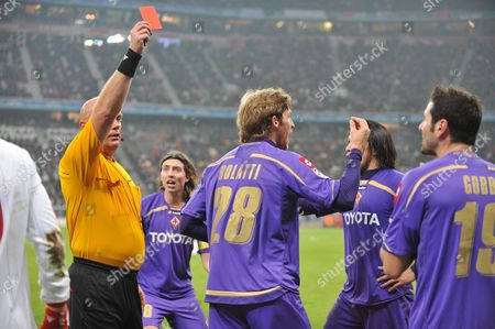 Referee Tom Henning Ovrebo (l) Shows Massimo Gobbi of Fiorentina the Red Card During the Champions League Match Bayern Munich Vs Ac Fiorentina in Munich Germany 17 February 2010 Germany Munich