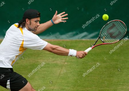 German Nicolas Kiefer Plays a Backhand During His First Round Match Against Russian Mikhail Youzhny at the Gerry Weber Open in Halle Germany 08 June 2010 Kiefer Defeated Zouzhny 4-6 6-1 and 7-5 Germany Halle