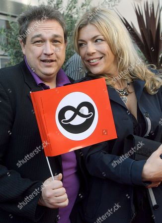 A Picture Dated 17 May 2009 Shows German Comedian Oliver Kalkofe and His Girlfriend Connie Frielinghaus Arriving at the German Premiere of the Musical 'The Producers' in Berlin Germany the German Adaption of Mel Brooks' Classic Musical was Presented at Admiralspalast the Red Flags with Black Prezels on White Ground Are a Satirical Reference to Nazi Flags Germany Berlin