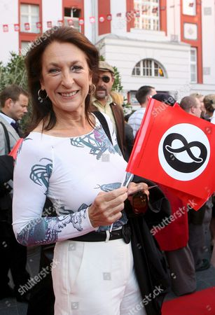 A Picture Dated 17 May 2009 Shows Actress Daniela Ziegler Arriving at the German Premiere of the Musical 'The Producers' in Berlin German the German Adaption of Mel Brooks' Classic Musical was Presented at Admiralspalast the Red Flags with Black Prezels on White Ground Are a Satirical Reference to Nazi Flags Germany Berlin