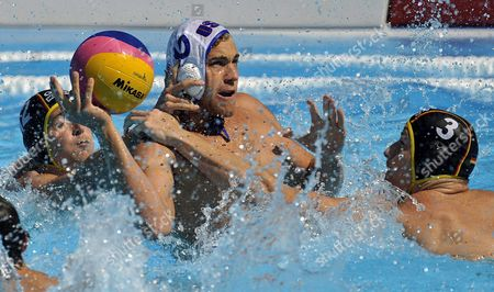 Germany's Soeren Mackeben (l) and Fabian Schroedter (r) and Usa's Peter Varellas Vie For the Ball During Their Water Polo Match at the Fina Swimming World Championships in Rome Italy 28 July 2009 Italy Rome