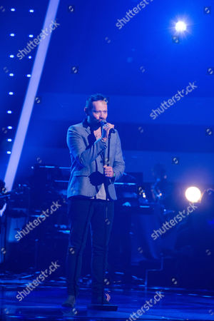Stock Photo of Hadleigh Ford performs This Year's Love by David Gray