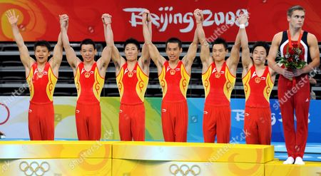 Chinese Athletes Yibing Chen Xu Huang Xiaopeng Li Qin Xiao Wei Yang an Kaiu Zou Celebrate Their Gold Medal After Winning the Mens Team Final at Artistic Gymnastics in the National Indoor Stadium Beijing China 12 August 2008 China Beijing