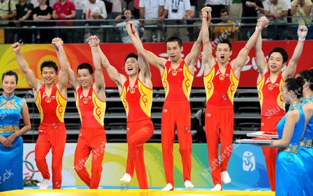 Chinese (from Left) Chen Yibing Huang Xu Li Xiaopeng Xiao Qin Yang Wei Zou Kai Celebrate Their Gold Medal After Winning the Men's Team Final at the Artistic Gymnastics in the National Indoor Stadium Beijing China 12 August 2008 China Beijing
