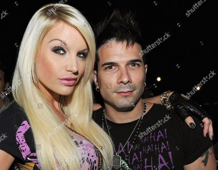 A Picture Dated 02 July 2009 Shows Us Singer Marc Terenzi (r) and Model Gina-lisa Lohfink Posing at the Party of the Label 'Ed Hardy' During the Fashion Fair 'Bread and Butter' at the Club Felix in Berlin Germany Spring/summer 2010 Fashion Trends Are Presented at the Berlin Fashion Week Until 04 July 2009 Germany Berlin