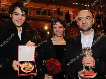 Director Florin Serban (r) Holds the Silver Bear - the Jury Grand Prix - For the Movie 'If i Want to Whistle i Whistle' Next to Romanian Actress Ada Condeescu and Romanian Actor George Pistereanu with Their Alfred Bauer Prize For the Film 'If i Want to Whistle i Whistle' After the Award Ceremony of the 60th Berlinale International Film Festival in Berlin Germany Saturday 20 February 2010 Up to 400 Films Are Shown Every Year As Part of the Berlinale's Public Programme the Berlinale is Divided Into Different Sections Each with Its Own Unique Profile Germany Berlin