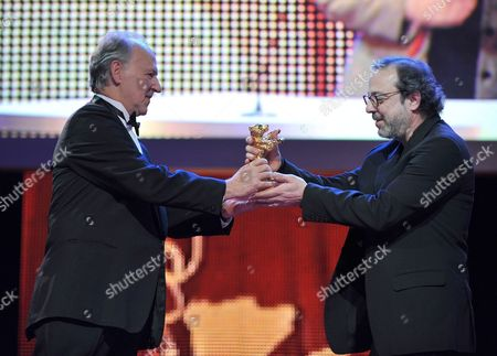Turkish Director Hasan Semih Kaplanoglu (r) Receives the Golden Bear For the Best Film For the Movie 'Honey' by Jury President Werner Herzog (l) During the Award Ceremony of the 60th Berlinale International Film Festival in Berlin Germany 20 February 2010 Up to 400 Films Are Shown Every Year As Part of the Berlinale's Public Programme the Berlinale is Divided Into Different Sections Each with Its Own Unique Profile Germany Berlin