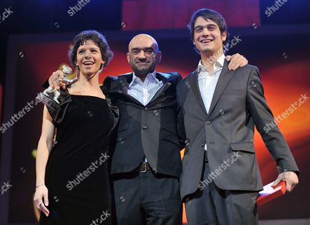 Romanian Director Florin Serban (c) Holds the Silver Bear - the Jury Grand Prix - For the Movie 'If i Want to Whistle i Whistle' Next to Romanian Actress Ada Condeescu (l) and Romanian Actor George Pistereanu with Their Alfred Bauer Prize For the Film 'If i Want to Whistle i Whistle' During the Award Ceremony of the 60th Berlinale International Film Festival in Berlin Germany Saturday 20 February 2010 the Alfred Bauer Prize is Awarded in Memory of the Festival Founder For a Feature Film That Broadens the Horizons of the Art of Filmmaking Germany Berlin