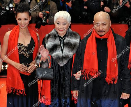 Chinese Actresses Monica Mo (l) and Lisa Lu and Chinese Director Wang Quan'an Arrive For the Premiere of the Opening Film 'Tuan Yuan' ('apart Together') That Runs in Competition of the 60th Berlin International Film Festival in Berlin Germany 11 February 2010 the Festival Runs Until 21 Febuary 2010 Germany Berlin