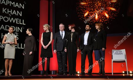 (l-r) German Tv Presenter Anke Engelke and the Jury Members Italian Actress Isabella Rossellini German Actress Nina Hoss Canadian Director Guy Maddin British Costume Designer Sandy Powell Indian Director Aamir Khan Australian Producer Jan Chapman Stand Next to an Empty Chair Bearing the Name of Jailed Iranian Director and Jury Member Jafar Panahi (r) on the Stage During the Awarding Ceremony of the 61st Berlinale International Film Festival in Berlin Germany on 19 February 2011 Evening a Total of 16 Films Had Been Competing For the Golden Bear the Presentation of the Berlinale Awards Were Held Against the Backdrop of the Six-year Jail Sentence Handed Down to Renowned Iranian Director Jafar Panahi the 50-year-old Panahi who Had Been Invited to Be a Member of the Berlinale Jury Has Also Been Banned From Filmmaking For the Next 20 Years on Charges of Working Against Iran's Ruling System Germany Berlin