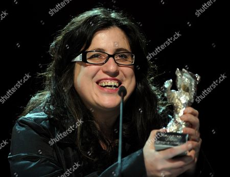 Stock Photo of Mexican Director Paula Markovitch Smiles As She Receives the 'Silver Bear' For Outstanding Artistic Achievement in the Category Camera For Her Film 'El Premio' During the Awarding Ceremony of the 61st Berlinale International Film Festival in Berlin Germany on 19 February 2011 Evening Germany Berlin