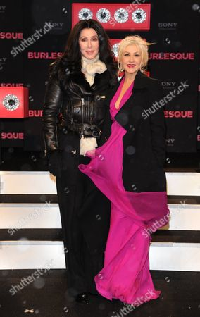Stock Photo of Us Singer and Actress Cher (l) and Us Singer-songwriter Dancer and Actress Christina Aguilera (r) Attend the German Premiere of the New Movie 'Burlesque' at Cinestar Cinema in Berlin Germany 16 December 2010 the Movie by Us Director Steve Antin Will Be Released in Germany on 06 January 2011 Germany Berlin