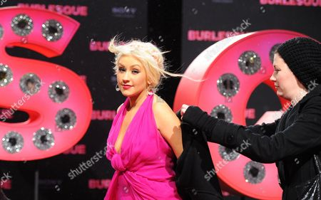Us Singer-songwriter Dancer and Actress Christina Aguilera (c) Attends the German Premiere of the New Movie 'Burlesque' at Cinestar Cinema in Berlin Germany 16 December 2010 the Movie by Us Director Steve Antin Will Be Released in Germany on 06 January 2011 Germany Berlin