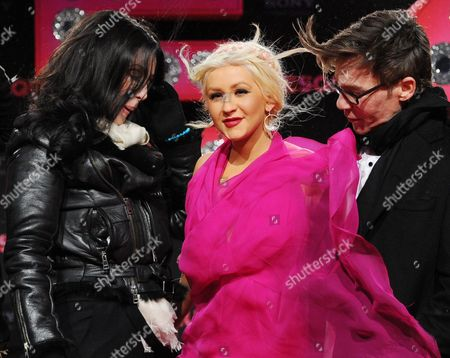 (l-r) Us Singer and Actress Cher Us Singer-songwriter Dancer and Actress Christina Aguilera and Us Director Steve Antin Attend the German Premiere of the New Movie 'Burlesque' at Cinestar Cinema in Berlin Germany 16 December 2010 the Movie by Steve Antin Will Be Released in Germany on 06 January 2011 Germany Berlin