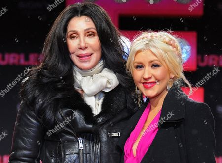 Us Singer and Actress Cher (l) and Us Singer-songwriter Dancer and Actress Christina Aguilera (r) Attend the German Premiere of the New Movie 'Burlesque' at Cinestar Cinema in Berlin Germany 16 December 2010 the Movie by Us Director Steve Antin Will Be Released in Germany on 06 January 2011 Germany Berlin