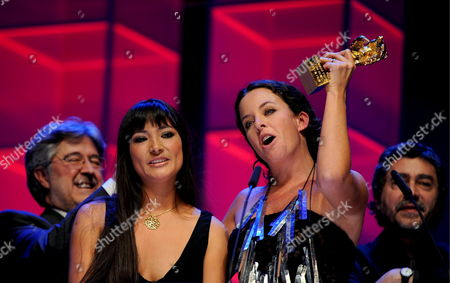 (l-r) Producer Jose Maria Morales Actress Magaly Solier Director Claudia Llosa and Producer Antonio Chavarrias Cheer During the Award Ceremony at the 59th Berlin International Film Festival in Berlin Germany 14 February 2009 Their Film 'The Milk of Sorrow' was Awarded with the Golden Bear For Best Film Germany Berlin