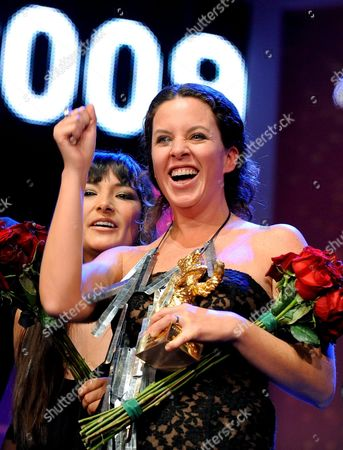 Director Claudia Llosa (r) and Actress Magaly Solier (l) Cheer During the Award Ceremony at the 59th Berlin International Film Festival in Berlin Germany 14 February 2009 Their Film 'The Milk of Sorrow' was Awarded with the Golden Bear For Best Film Germany Berlin