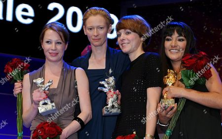 (l-r) Austrian Actress Birgit Minichmayr President of the Berlina Jury Tilda Swinton German Director Maren Ade and Actress Magaly Solier Pose During the Award Ceremony at the 59th Berlin International Film Festival in Berlin Germany 14 February 2009 the Film 'The Milk of Sorrow' by Llosa with Solier was Awarded with the Golden Bear For Best Film Ade's Film 'Everyone Else' was Awarded with the Silver Bear Jury Grand Prix Starring Minichmayr who was Awarded with the Silver Bear Best Actress For Her Performance in the Film Germany Berlin