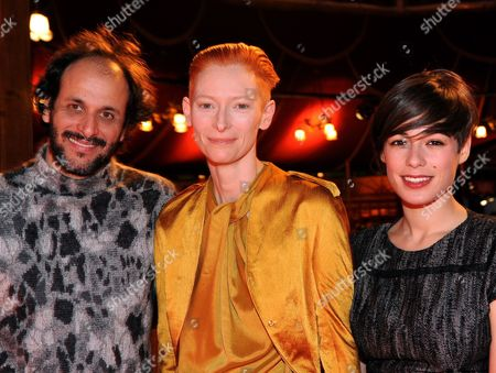 Italian Director Luca Guadagnino (l-r) British Actress Tilda Swinton and Italian Actress Diane Fleri Pose in the Restaurant 'Gropius Mirror' During the Event 'Kulinarisches Kino' (culinary Cinema) As Part of the 60th Berlinale International Film Festival in Berlin Germany Sunday 14 Febuary 2010 the Guest of Culinary Cinema Watched a Film and Later They Were Served with a Menu Accordingly Germany Berlin