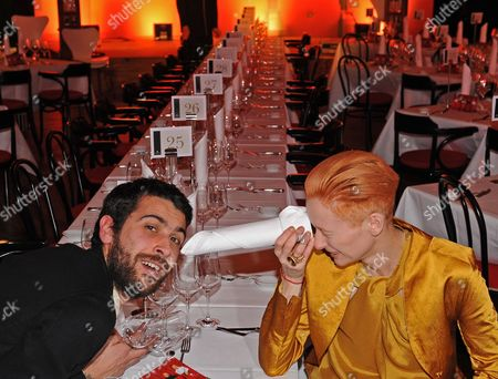 Italien Actor Edoardo Gabbriellini and British Actress Tilda Swinton Sitting in the Restaurant 'Gropius Mirror' During the Event 'Kulinarisches Kino' (culinary Cinema) As Part of the 60th Berlinale International Film Festival in Berlin Germany Sunday 14 Febuary 2010 the Guest of Culinary Cinema Watched a Film and Later They Were Served with a Menu Accordingly Germany Berlin