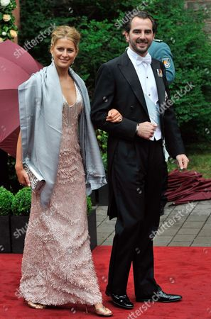 Stock Photo of Prince Nikolaos of Greece (r) and His Wife Tatiana Blatnik Leave After the Religious Wedding of Princess Nathalie of Sayn-wittgenstein-berleburg and Alexander Johannsmann at the Evangelical Church of the Castle in Bad Berleburg Germany 18 June 2011 Germany Bad Berleburg