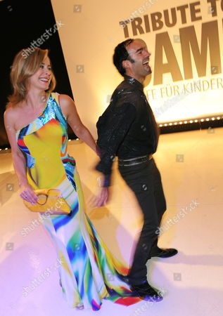A Picture Dated 09 October 2009 Shows German Television Host Bettina Cramer (l) and Fashion Designer Ivan Strano Attending the 'Tribute to Bambi' Gala at the 'Station-berlin' in Berlin Germany the Proceeds From the Charity Event Benefit the Foundation 'Tribute to Bambi' That Supports Children in Need in Germany Germany Berlin