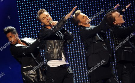 Stock Image of Alexej Vorobjov (2-l) Representing Russia Performs During the Final of the Eurovision Song Contest in Duesseldorf Germany 14 May 2011 25 Participants Are Competing For the Trophy of the 56th Eurovision Song Contest Germany Duesseldorf