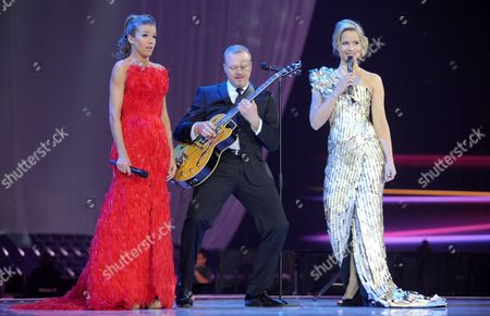 Anke Engelke (l-r) Stefan Raab and Judith Rakers Hosts of the Eurovision Song Contest 2011 Seen on Stage During Dress Rehearsal For the Final of the Eurovision Song Contest in Duesseldorf Germany 13 May 2011 the Finale of the 56th Eurovision Song Contest Takes Place on 14 May 2011 Germany Duesseldorf