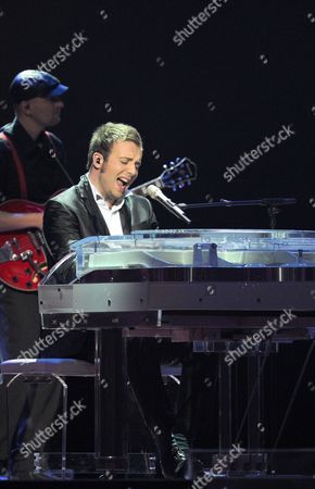 Amaury Vassili Representing France Performs During a Dress Rehearsal For the Grand Final of the Eurovision Song Contest in Duesseldorf Germany 13 May 2011 the Grand Final of the 56th Eurovision Song Contest Takes Place on 14 May Germany Duesseldorf