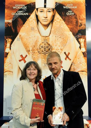 Us Author Donna Woolfolk Cross (l) Holding Her Book 'Die P?pstin' (us Title: 'Pope Joan') and German Director Soenke Wortmann (r) Pose in Front of the Poster of His Movie 'Pope Joan' at the Frankfurt Book Fair 2009 in Frankfurt Germany 18 October 2009 the Movie 'Pope Joan' is an Adaptation of the Novel Written by Donna Woolfolk Cross Germany Frankfurt Am Main