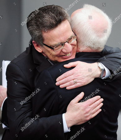 The Last Gdr Prime Minister Lothar De Maiziere (r) Hugs with His Cousin German Minister of Interiors Thomas De Maiziere After Delivering a Speech to German Bundestag During a Ceremony in Berlin Germany 18 March 2010 German Bundestag Commemorated the 20th Anniversary of the First and Only Free Elections in the Gdr Held on 18 March 1990 Germany Berlin